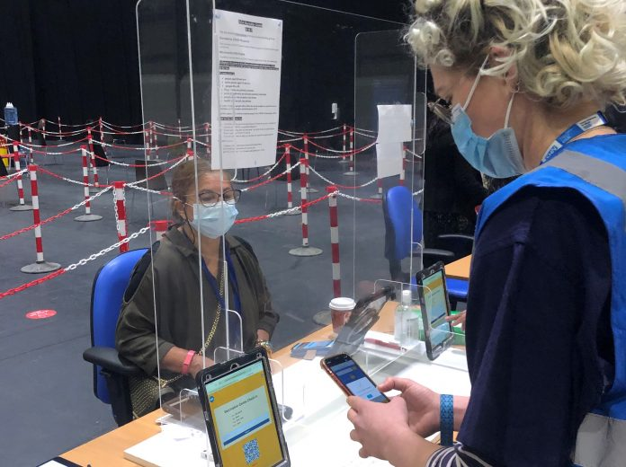 Tracking Induction and Training at a London COVID-19 Vaccination Center